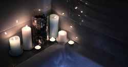 Burning candles in the spa salon. Concept