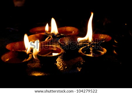 Burning candles on altar  in buddhist temple, Sri Lanka