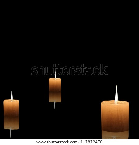 Burning Candles on black background with place for your design