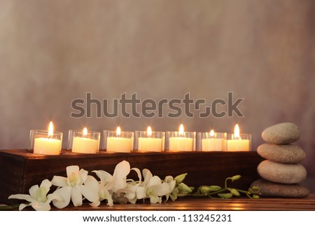 Burning candles,orchid flower and zen stone,zen concept.