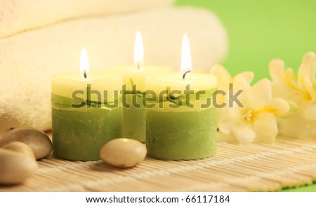 burning candles stones and spa towels