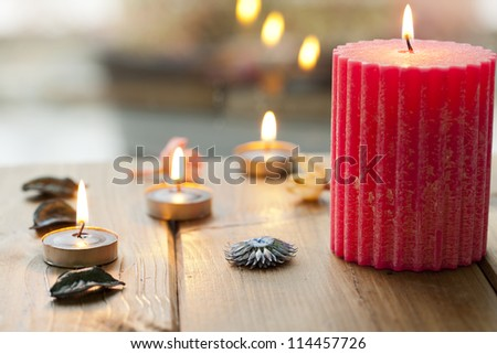 Burning candles with aromatic flowers