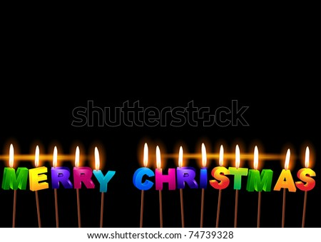 "Burning candles with the words ""Merry Christmas"""