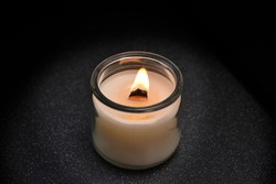 burning candles with wooden wick and large flame