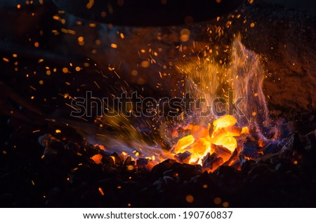 burning charcoal background...