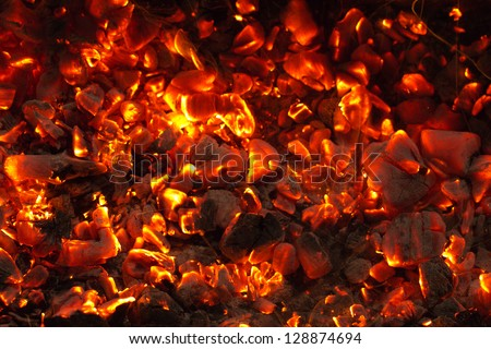 burning charcoal in the background