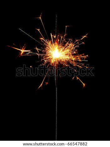 Burning christmas sparkler isolated on black background