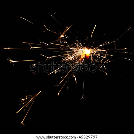 burning christmas sparklers isolated on black background