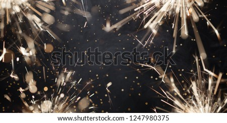Burning christmas sparklers with sparks and smoke. New year's background #1247980375