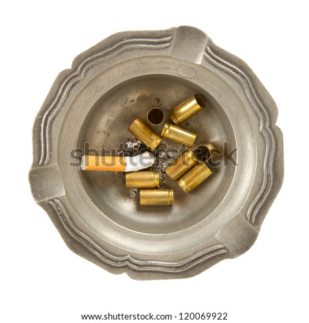 Burning cigarette and empty 9mm bullet casings in an old tin ashtray, isolated