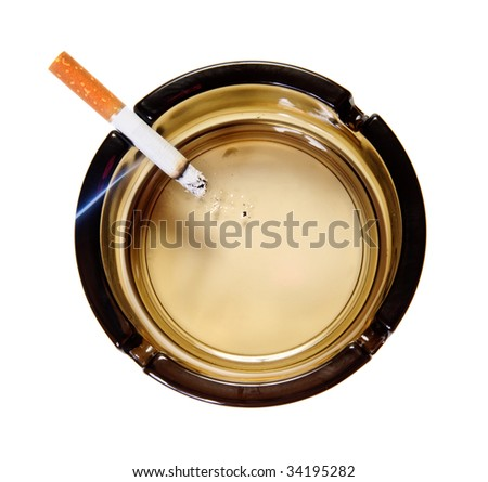 Burning cigarette in ash tray. Top view. Isolated