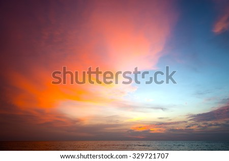 Burning clouds and tropical sea after the sun is set