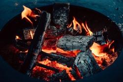 Burning coals at night ,Decaying charcoal, barbeque season