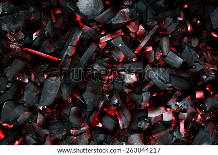 Burning coals. Decaying charcoal. Backround with charcoal.