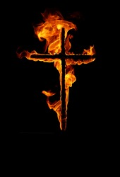 burning cross in black background