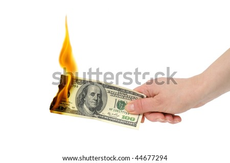 burning dollar in hand isolated on a white