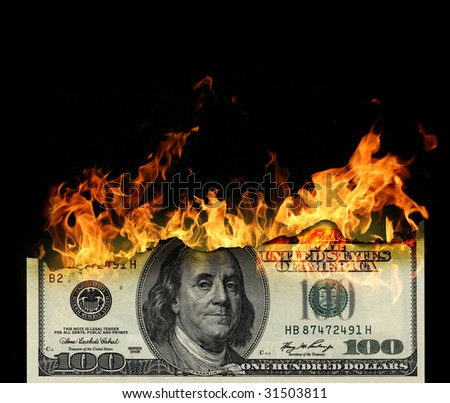 Burning dollars close up over black background