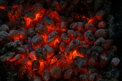 Burning embers of the fireplace top view. Close up. Burning Coal.