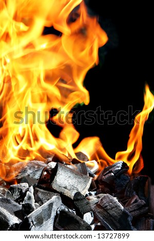 Burning fire and charcoal, may be used as background