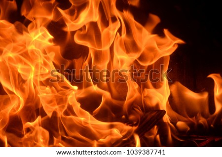 Burning fire with red, orange and yellow flames background. Arson, house fire, fire safety and fire danger theme. Stock photo ©