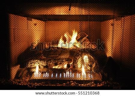Burning fireplace  #551210368