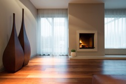 Burning fireplace and designed decoration in living room