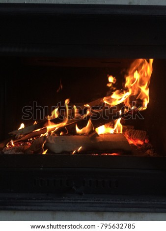 Burning fireplace. fire in the fireplace. operating fireplace. burning wood in the fireplace #795632785