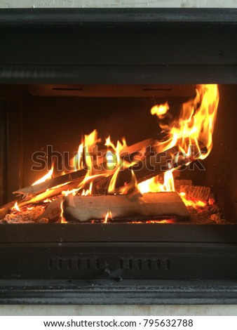 Burning fireplace. fire in the fireplace. operating fireplace. burning wood in the fireplace #795632788