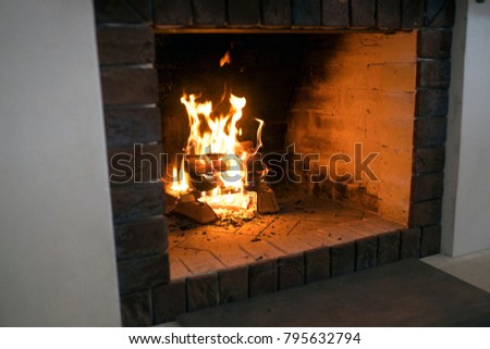 Burning fireplace. fire in the fireplace. operating fireplace. burning wood in the fireplace #795632794