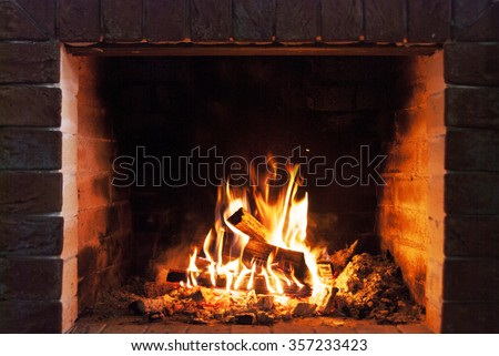 Burning fireplace. Fireplace as a piece of furniture - Shutterstock ID 357233423