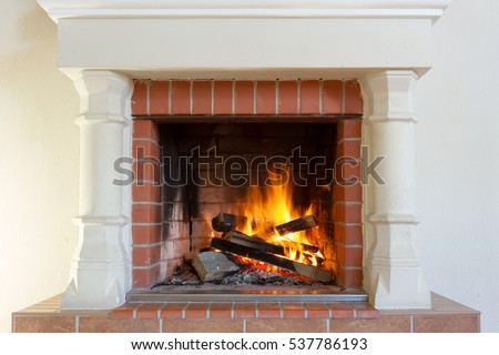 Burning fireplace. Fireplace as a piece of furniture #537786193