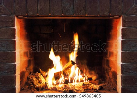 Burning fireplace. Fireplace as a piece of furniture #549865405