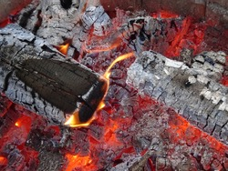 burning firewood and hot coals in an open fireplace