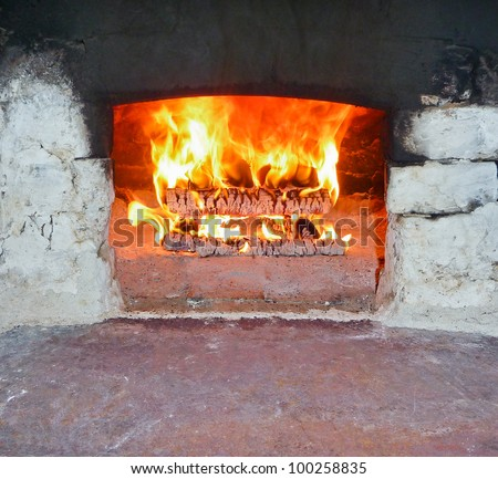 Burning Firewood in the brick Furnace