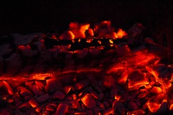 Burning firewood in the fireplace close up, BBQ fire, charcoal background