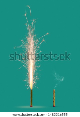 Burning firework with bright sparkes and smoke from burnt candle on a turquoise background, copy space. Concept of festive event. #1483316555