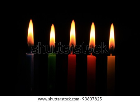 burning five colors candles in a row