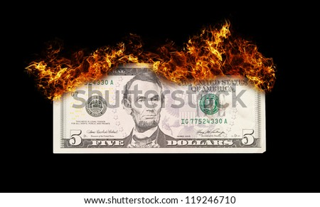 Burning five dollar bill symbolizing careless money management and the phrase money to burn