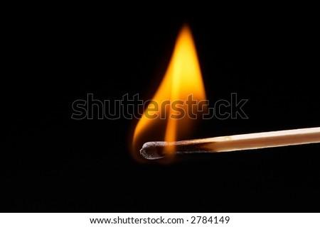 burning, flaming match on black background - landscape format