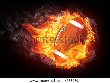 Burning football ball enveloped in fire flame isolated on black background.