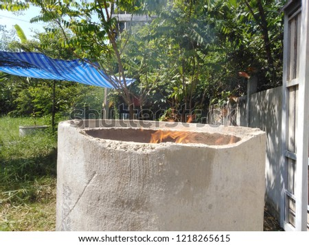 Burning garbage in the cement pipe make a terrible fire and smog, cause of air pollution. #1218265615