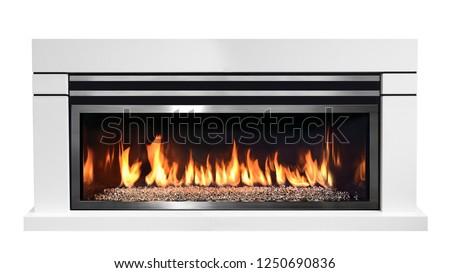 Burning gas fireplace isolated on white background. #1250690836