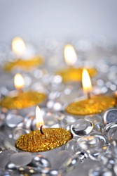 Burning golden decorative Christmas candles with glass beads