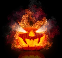 Burning halloween pumpkin, isolated on black background