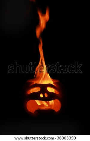 burning halloween pumpkin on dark background