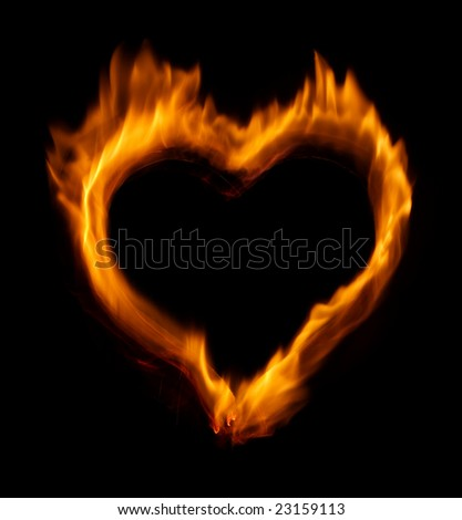 Burning heart over black background