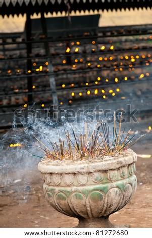 Burning incense sticks in a buddhist temple in Sri Lanka
