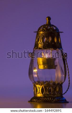 Burning lantern in the dark