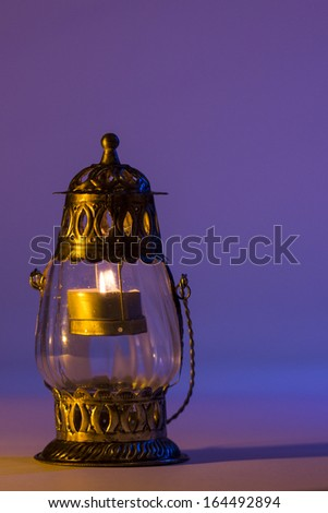 Burning lantern in the dark