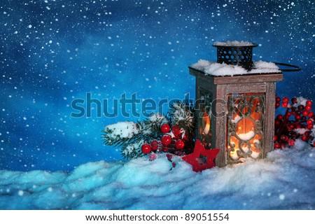 Burning lantern in the snow at night - Shutterstock ID 89051554